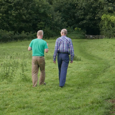 Two men walking on a Summer's day